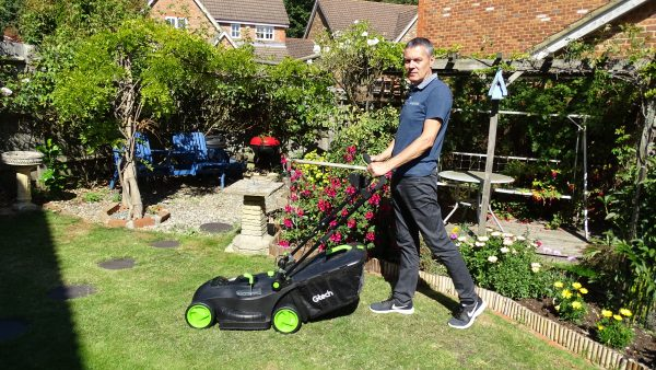 The Gtech Cordless Lawnmower 2.0 in use